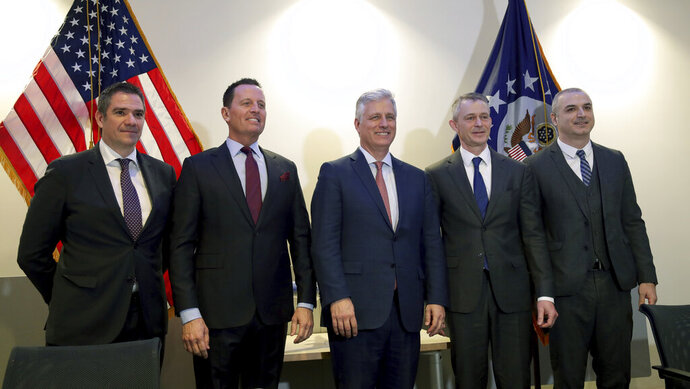 From left, Milun Trivunac, State Secretary of the Ministry of Economy of the Republic of Serbia, Richard Grenell, left, United States Ambassador to Germany, Robert C. O'Brien, United States National Security Advisor, Michael Knitter, Managing Director of Eurowings, and Eset Berisha, Director General, Civil Aviation Authority of Kosovo, pose for the media during a press conference in Berlin, Germany, Monday, Jan. 20, 2020 after the signing of an agreement between Kosovo and Serbia, establishing air service between the two capitals. (AP Photo/Michael Sohn)