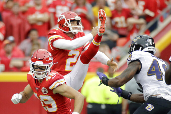 "FILE - In this Sept. 22, 2019, file photo, Kansas City Chiefs punter Dustin Colquitt (2) punts the ball during the second half of an NFL football game against the Baltimore Ravens in Kansas City, Mo. The Kansas City Chiefs are releasing two-time Pro Bowl punter Dustin Colquitt, whose 15-year career with the franchise allowed him to set numerous club records, including the most games played and most postseason appearances. Colquitt, who turns 38 next month, posted a farewell on Instagram late Monday, April 27, 2020, in which he said that ""all things come to an end, sometimes sooner than you hoped, prayed and pleaded for them to."" A person familiar with the team's decision confirmed it to The Associated Press on condition of anonymity Tuesday because it had not been announced. (AP Photo/Charlie Riedel, File)"