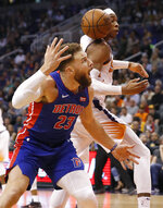 Phoenix Suns forward Richaun Holmes and Detroit Pistons forward Blake Griffin (23) look for the ball during the second half of an NBA basketball game Thursday, March 21, 2019, in Phoenix. (AP Photo/Matt York)