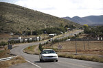 A car passes through Colonia LeBaron, one of many locations where the extended LeBaron family lives in the Galeana municipality of Chihuahua state in northern Mexico, Tuesday, Nov. 5, 2019. Drug cartel gunmen ambushed on Monday three vehicles along a road near the state border of Chihuahua and Sonora, slaughtering at least six children and three women from the extended LeBaron family, all of them U.S. citizens living in northern Mexico, authorities said Tuesday. (AP Photo/Christian Chavez)