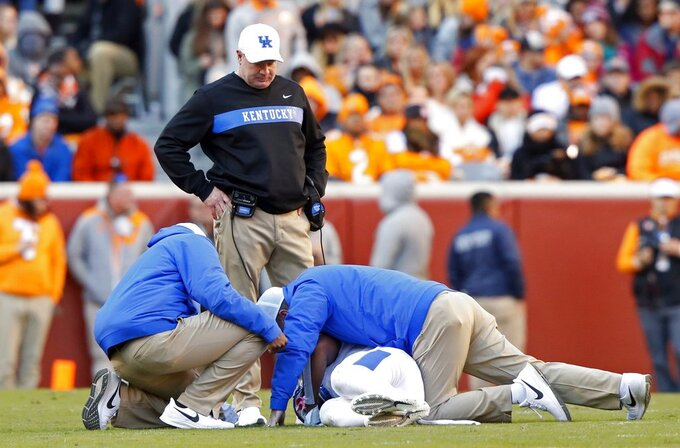 Kentucky head coach Mark Stoops looks on as medical staff look at Mike Edwards in the first half of an NCAA college football game against Tennessee Saturday, Nov. 10, 2018, in Knoxville, Tenn. (AP Photo/Wade Payne)