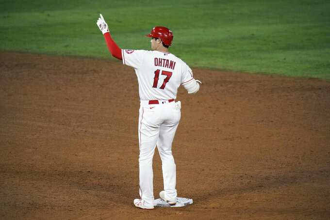 Los Angeles Angels' Shohei Ohtani, of Japan, celebrates his RBI double during the sixth inning of a baseball game against the Los Angeles Dodgers, Friday, May 7, 2021, in Anaheim, Calif. (AP Photo/Jae C. Hong)