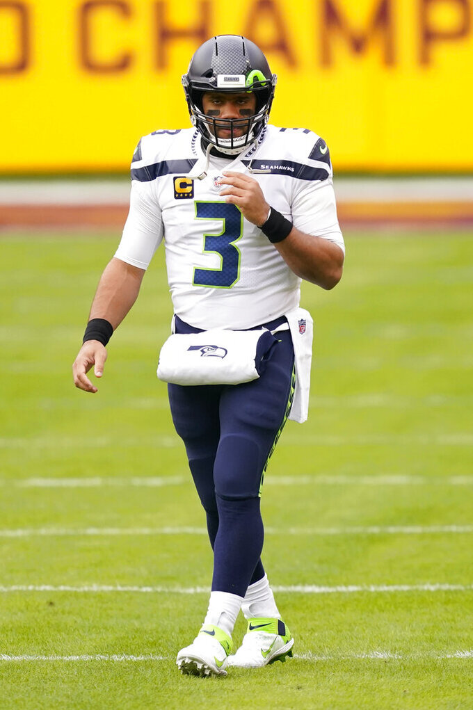 Seattle Seahawks quarterback Russell Wilson (3) takes the field before the start of an NFL football game against the Washington Football Team, Sunday, Dec. 20, 2020, in Landover, Md. (AP Photo/Andrew Harnik)