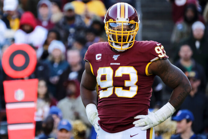 FILE - In this Dec. 15, 2019, file photo, Washington Redskins defensive end Jonathan Allen stands on the field during an NFL football game against the Philadelphia Eagles in Landover, Md. The Washington Redskins have exercised the fifth-year option on defensive lineman Jonathan Allen's rookie contract. The team announced the expected move Monday, April 27, 2020, in the aftermath of the NFL draft. (AP Photo/Mark Tenally, File)