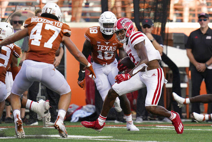 Louisiana-Lafayette wide receiver Kyren Lacy (2) runs for a touchdown against Texas during the second half of an NCAA college football game, Saturday, Sept. 4, 2021, in Austin, Texas. (AP Photo/Eric Gay)