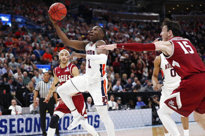Auburn guard Jared Harper (1) drives to the hoop against New Mexico State forward Ivan Aurrecoechea (15) in the second half during a first round men's college basketball game in the NCAA Tournament, Thursday, March 21, 2019, in Salt Lake City. (AP Photo/Jeff Swinger)