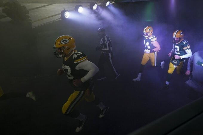 The Green Bay Packers are introduced before an NFL football game against the Carolina Panthers Saturday, Dec. 19, 2020, in Green Bay, Wis. (AP Photo/Morry Gash)