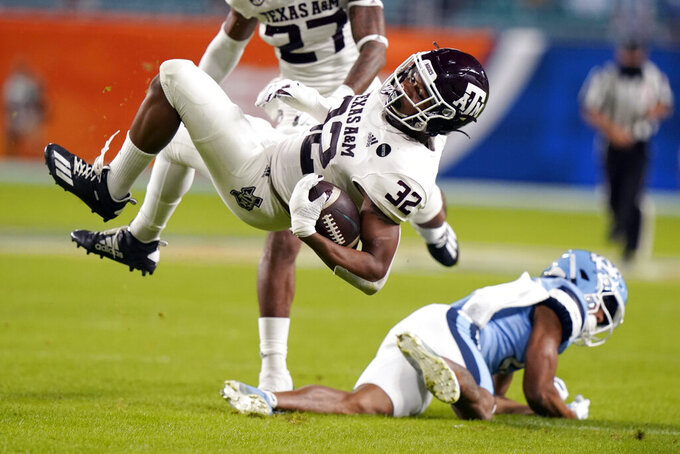 Texas A&M linebacker Andre White Jr. (32) intercepts a pass thrown by North Carolina quarterback Sam Howell during the first half of the Orange Bowl NCAA college football game, Saturday, Jan. 2, 2021, in Miami Gardens, Fla. (AP Photo/Lynne Sladky)