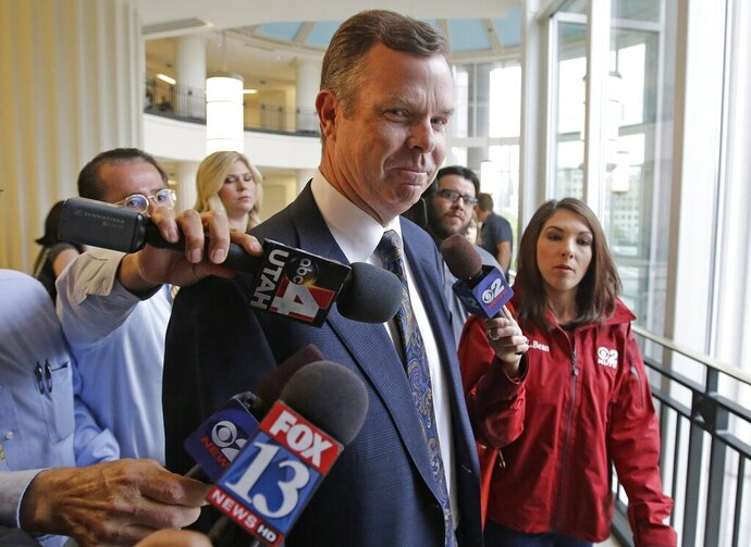 FILE - In this July 30, 2014, file photo, former Utah Attorney General John Swallow arrives at court in Salt Lake City. The Utah Legislature has formally approved a settlement with Swallow after he was acquitted of bribery. The $1.5 million settlement was agreed upon in a special session Monday, Sept. 16, 2019, to reimburse the former attorney general for his legal fees. (AP Photo/Rick Bowmer, File)