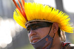 An Indigenous man reacts after the Supreme Court judges' decision to suspend the vote that defines the demarcation of Indigenous lands, during a protest in front of the Supreme Court building, in Brasilia, Brazil, Wednesday, Sept. 15, 2021. (AP Photo/Eraldo Peres)