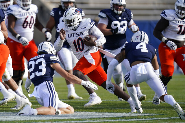 UTSA quarterback Lowell Narcisse (10) carries the ball as BYU's Zayne Anderson (23) and Troy Warner (4) close in for a tackle in the second half during an NCAA college football game Saturday, Oct. 10, 2020, in Provo, Utah. (AP Photo/Rick Bowmer, Pool)