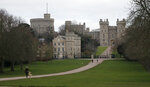 Pedestrians walk the Long Walk in front of Windsor Castle, near the Frogmore Cottage home of Britain's Prince Harry and Meghan Duchess of Sussex in Windsor, Friday, Jan. 10, 2020. Britain's Prince Harry and his wife, Meghan, said they are planning