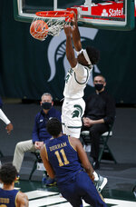 Michigan State's Gabe Brown dunks over Notre Dame's Juwan Durham (11) during the first half of an NCAA college basketball game Saturday, Nov. 28, 2020, in East Lansing, Mich. (AP Photo/Al Goldis)
