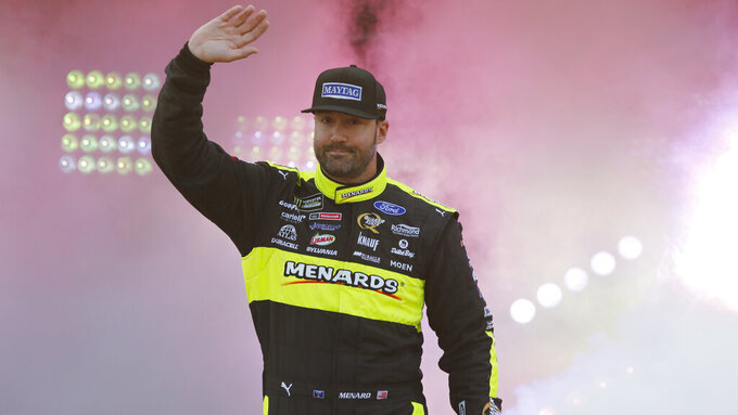Paul Menard waves to fans during driver introductions prior to the start of the NASCAR Cup series auto race at Richmond Raceway in Richmond, Va., Saturday, April 13, 2019. (AP Photo/Steve Helber)
