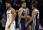 Butler forward Jordan Tucker (1) celebrates with guard Aaron Thompson, right, as DePaul guard Eli Cain walks past after Butler defeated DePaul 87-69 in an NCAA college basketball game Wednesday, Jan. 16, 2019, in Chicago. (AP Photo/Nam Y. Huh)