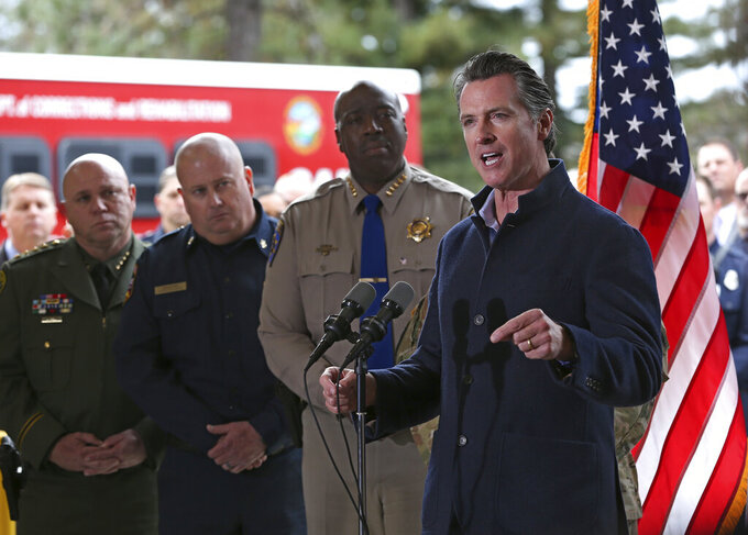 FILE — In this Jan. 8, 2019 file photo Gov. Gavin Newsom discusses emergency preparedness during a visit to the California Department of Forestry and Fire Protection CalFire Colfax Station in Colfax, Calif. On his first full day as governor, Newsom announced executive actions to improve the state's response to wildfires and other emergencies. Newsom has vastly overstated wildfire prevention work done under his administration according to an investigation by Capital Public Radio, published Wednesday, June, 23, 2021. (AP Photo/Rich Pedroncelli, File )