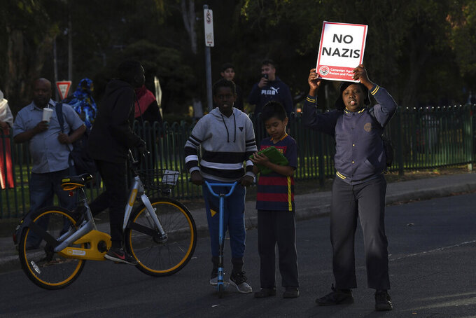 """A young boy carries a placard titled """"No Nazis"""" during a demonstration in Melbourne on Dec. 4, 2017. Australia's Victoria state is drafting legislation that would make it the first in the country to ban the public display of Nazi symbols as local neo-Nazi activity increases. (James RossAAP Image via AP)"""