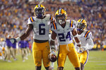 LSU cornerback Derek Stingley Jr. (24) celebrates his interception in the end zone with linebacker Brenton Cox Jr. (6) in the second half of an NCAA college football game against Florida in Baton Rouge, La., Saturday, Oct. 12, 2019. LSU won 42-28. (AP Photo/Gerald Herbert)