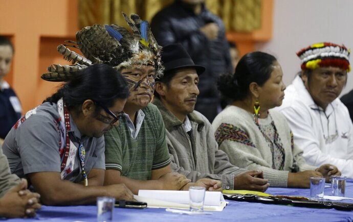 Indigenous leaders attend negotiations with President Lenin Moreno in Quito, Ecuador, Sunday, Oct. 13, 2019. The government and indigenous protesters started negotiations aimed at defusing more than a week of demonstrations that have paralyzed the nation's economy. (AP Photo/Fernando Vergara)