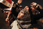 FILE - In this Feb. 11, 2011 file photo, an Egyptian woman cries as she celebrates the news of the resignation of President Hosni Mubarak, who handed control of the country to the military, in Tahrir Square, Cairo, Egypt. A decade later, thousands are estimated to have fled abroad to escape a state, headed by President Abdel Fattah el-Sissi, that is even more oppressive. (AP Photo/Tara Todras-Whitehill, File)