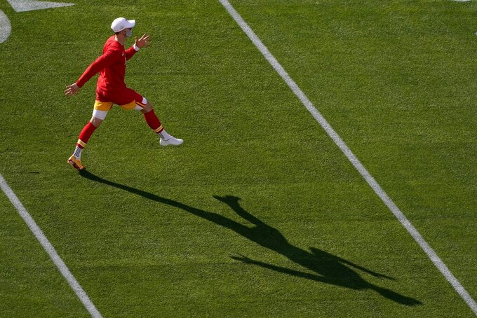 Kansas City Chiefs' Harrison Butker warms up before the NFL Super Bowl 55 football game between the Kansas City Chiefs and Tampa Bay Buccaneers, Sunday, Feb. 7, 2021, in Tampa, Fla. (AP Photo/Charlie Riedel)