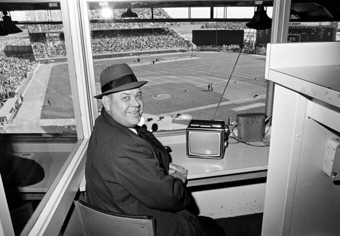 FILE - In this Sept. 26, 1965, file photo, Calvin Griffith, president of the Minnesota Twins, sits in the press box at Metropolitan Stadium watching the Twins on television and awaiting the start of the Minnesota Vikings-Detroit Lions NFL game, in Minneapolis. The Minnesota Twins say they've removed a statue of former owner Calvin Griffith at Target Field, citing racist remarks he made in 1978. (AP Photo/Gene Herrick, File)