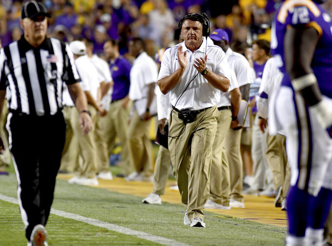 LSU head coach Ed Orgeron shows his approval after an LSU score in the first half of an NCAA football game against Northwestern State Saturday in Baton Rouge, La., Sept. 14, 2019. (AP Photo/Patrick Dennis)