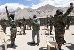 In this handout photo provided by the Press Information Bureau, Indian Prime Minister Narendra Modi greets soldiers during a visit to Nimu, Ladakh area, India, Friday, July 3, 2020. Modi made an unannounced visit Friday to a military base in remote Ladakh region bordering China where the soldiers of the two countries have been facing off for nearly two months. Modi's visit comes in the backdrop of massive Indian army build-up in Ladakh region following hand-to-hand combat between Indian and Chinese soldiers on June 15 that left 20 Indian soldiers dead and dozens injured, the worst military confrontation in over four decades between the Asian giants. (Press Information Bureau via AP)