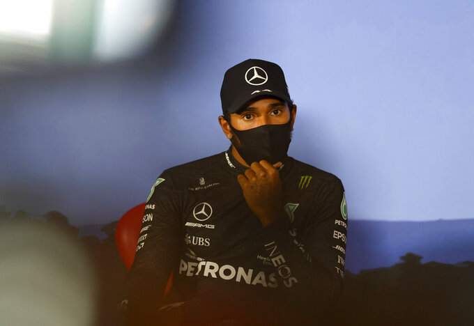 Mercedes driver Lewis Hamilton of Britain, wearing a mask against the spread of the coronavirus, attends a press conference after he clocked the second fastest time during the qualifying session at the Red Bull Ring racetrack in Spielberg, Austria, Saturday, July 4, 2020. The Austrian Formula One Grand Prix will be held on Sunday. (Mario Renzi/Pool via AP)