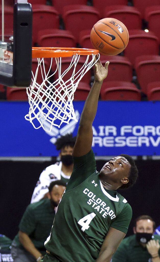 Colorado State guard Isaiah Stevens (4) shoots during the second half of an NCAA college basketball game against Utah State in the semifinal round of the Mountain West Conference men's tournament Friday, March 12, 2021, in Las Vegas. (AP Photo/Isaac Brekken)