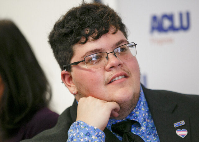 FILE - In this July 23, 2019, file photo, Gavin Grimm, who has become a national face for transgender students, speaks during a news conference held by The ACLU and the ACLU of Virginia at Slover Library in Norfolk, Va. A federal appeals court is hearing arguments Tuesday, May 26, 2020, in the case of Grimm who sued a Virginia school board after he was barred as a student from using the boys' bathrooms at his high school. A judge ruled last year that the Gloucester County School Board had discriminated against Grimm. (Kristen Zeis/The Daily Press via AP, File)