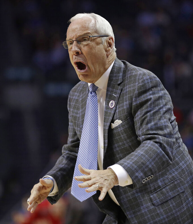 North Carolina head coach Roy Williams reacts to a call during the first half of an NCAA college basketball game against Louisville in the Atlantic Coast Conference tournament in Charlotte, N.C., Thursday, March 14, 2019. (AP Photo/Nell Redmond)