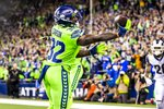 Seattle Seahawks running back Chris Carson bobbles but brings down a 5-yard touchdown reception during the fourth quarter against the Los Angeles Rams in an NFL football game in Seattle on Thursday, Oct. 3, 2019. The Seahawks won 30-29. (Andy Bao/The Seattle Times via AP)