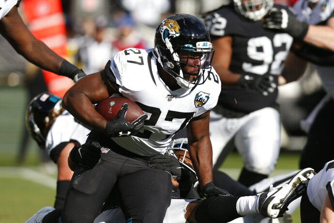 Jacksonville Jaguars running back Leonard Fournette runs with the ball during the second half of an NFL football game against the Oakland Raiders in Oakland, Calif., Sunday, Dec. 15, 2019. (AP Photo/D. Ross Cameron)