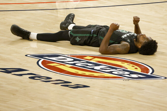 Tulane guard Jordan Walker (2) stays on the floor for a moment after a collision against Houston during the second half of an NCAA college basketball game in the quarterfinal round of the American Athletic Conference men's tournament Friday, March 12, 2021, in Fort Worth, Texas. (AP Photo/Ron Jenkins)