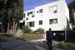 FILE - This Jan. 8, 2019 file photo shows the building housing the apartment of Ed Buck in West Hollywood, Calif., following the death of a man the previous day. The prominent LGBTQ political activist was arrested Tuesday, Sept. 17, 2019 and charged with operating a drug house and providing methamphetamine to a 37-year-old man who overdosed on Sept. 11, but survived, officials said. Two other men have died in his apartment since 2017. (AP Photo/Jae C. Hong, File)