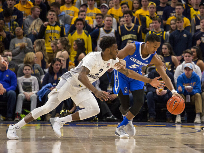 Creighton guard Ty-Shon Alexander, right, defends against Marquette forward Sacar Anim, left, during the first half of an NCAA college basketball game Sunday, March 3, 2019, in Milwaukee. (AP Photo/Darren Hauck)