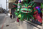 Piñatas depicting the new coronavirus are displayed in a store at Colon park in Guatemala City, Tuesday, April 14, 2020. The piñatas sell for about $1.50 depending on size. (AP Photo/Moises Castillo)