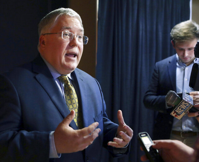 FILE - In this Nov. 1, 2018, file photo, Patrick Morrisey speaks to reporters after a debate in Morgantown, W.Va. Isaac Sponaugle conceded the Democratic primary for West Virginia attorney general to labor lawyer Sam Petsonk on Tuesday, June 23, 2020 capping a close race decided by fewer than 200 votes weeks after election day. He is now set to face incumbent Republican Attorney General Patrick Morrisey in the November elections. Morrisey ran unopposed in the GOP primary. (AP Photo/Raymond Thompson, File)