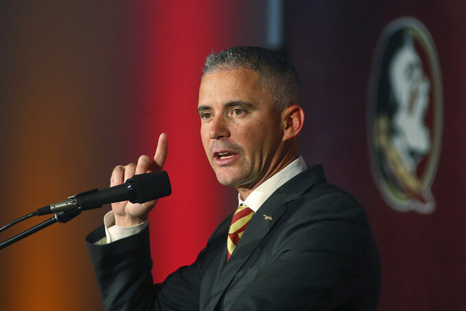 Florida State head football coach Mike Norvell speaks at a news conference Sunday, Dec. 8, 2019, in Tallahassee, Fla. Norvell is Florida State's new coach, taking over a Seminoles program that has struggled while he was helping to build Memphis into a Group of Five power. (AP Photo/Phil Sears)
