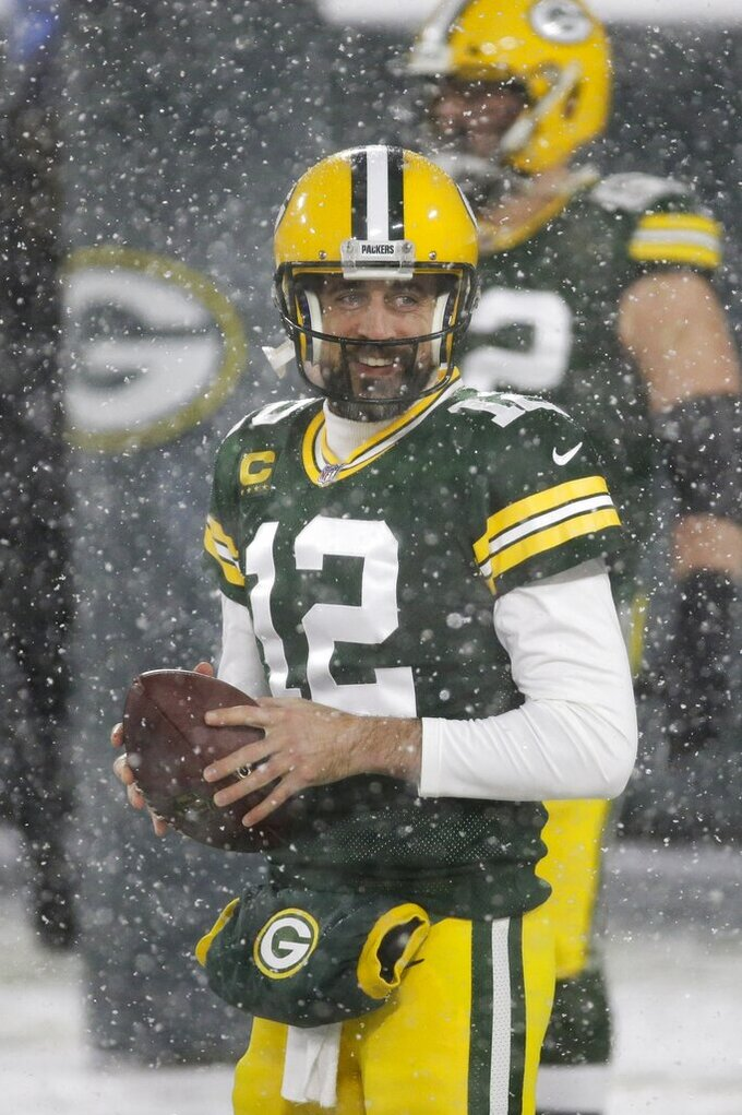 Green Bay Packers' Aaron Rodgers warms up before an NFL football game against the Tennessee Titans Sunday, Dec. 27, 2020, in Green Bay, Wis. (AP Photo/Mike Roemer)
