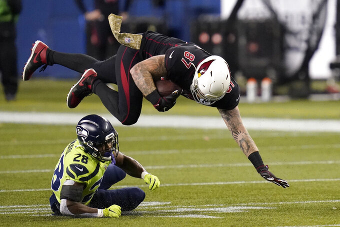 Arizona Cardinals Arizona Cardinals tight end Maxx Williams (87) is upended by Seattle Seahawks Seattle Seahawks safety Ugo Amadi (28) during the second half of an NFL football game, Thursday, Nov. 19, 2020, in Seattle. (AP Photo/Elaine Thompson)