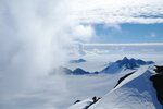 In this 2011 photo provided by researcher Hamish Pritchard, summer clouds swirl around the Staccato Peaks of Alexander Island off the Antarctic Peninsula. In a study released Wednesday, June 13, 2018, an international team of ice experts said the melting of Antarctica is accelerating at an alarming rate, with about 3 trillion tons of ice disappearing since 1992.(Hamish Pritchard/British Antarctic Survey via AP)