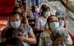 Passengers wearing face-masks to reduce spread of the coronavirus, ride a canal ferry in Bangkok, Thailand, Wednesday, Jan. 6, 2021. Thailand planned to expand testing to thousands of factories in a province next to Bangkok as it reported over 300 new virus cases around the country on Wednesday and one new death, an official said. (AP Photo/Gemunu Amarasinghe)