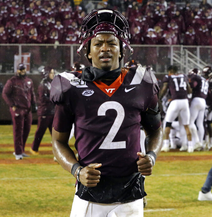 Virginia Tech quarterback Hendon Hooker (2) runs towards the locker room at the conclusion of the of an NCAA football game against Pittsburgh in Blacksburg Va. Saturday, Nov. 23 2019. Virginia Tech won the game 28-0. (Matt Gentry/The Roanoke Times via AP)