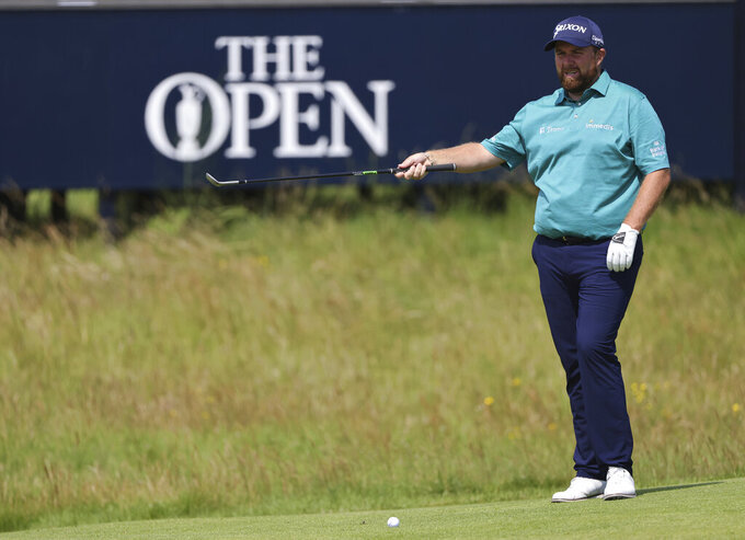 Ireland's Shane Lowry putts on the 2nd green during a practice round for the British Open Golf Championship at Royal St George's golf course Sandwich, England, Tuesday, July 13, 2021. The Open starts Thursday, July, 15. (AP Photo/Ian Walton)