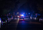 In this Wednesday, Sept. 18, 2019 photo, police work the scene of a homicide in St. Paul, Minn. (Renee Jones Schneider/Star Tribune via AP)