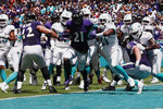 Baltimore Ravens running back Mark Ingram (21) scores a touchdown, during the first half at an NFL football game against the Miami Dolphins, Sunday, Sept. 8, 2019, in Miami Gardens, Fla. (AP Photo/Brynn Anderson)