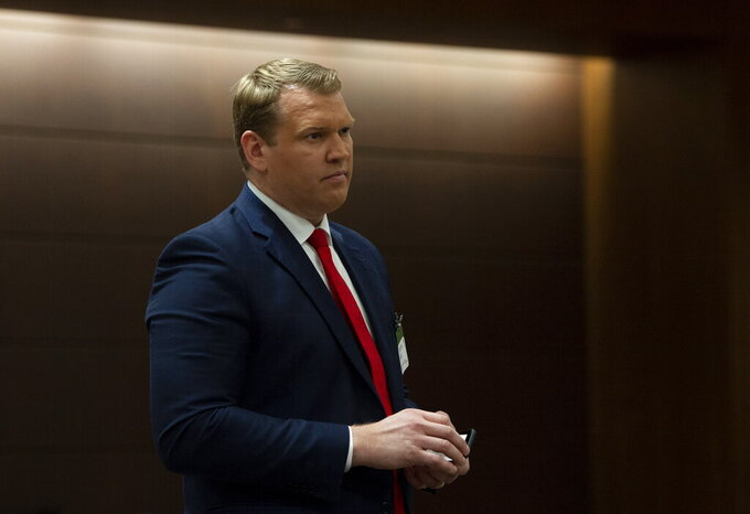 FILE - Co-founder and CEO of the Concussion Legacy Foundation Chris Nowinski waits to appear at the House of Commons' Health committee on sports-related concussions in Ottawa, Ontario, in this Wednesday, Feb. 6, 2019, file photo. With the COVID-19 pandemic pushing the 2020 FCS season from fall to spring, and the 2021 fall season planned to be played as usual, it begs the question: How much football is too much football? (Adrian Wyld/The Canadian Press via AP, File)