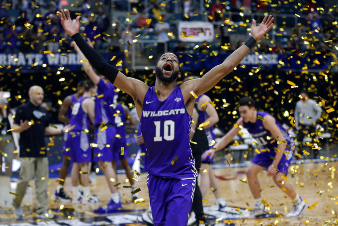 Abilene Christian guard Reggie Miller (10) celebrates as confetti falls onto the court after the team's 79-45 win over Nicholls State in an NCAA college basketball game for the Southland Conference men's tournament championship Saturday, March 13, 2021, in Katy, Texas. (AP Photo/Michael Wyke)